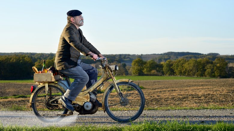 french farmer on bicycle