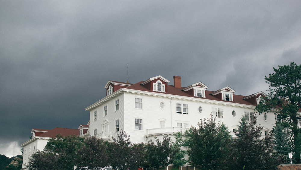 Exterior of Stanley Hotel with gray clouds