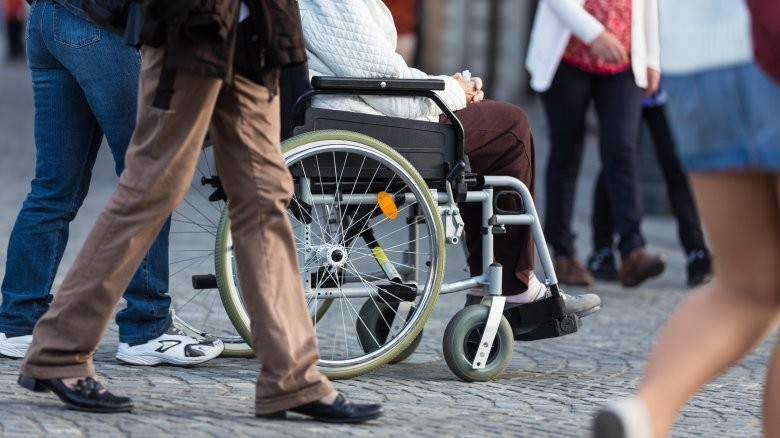 Wheelchair in a crowd