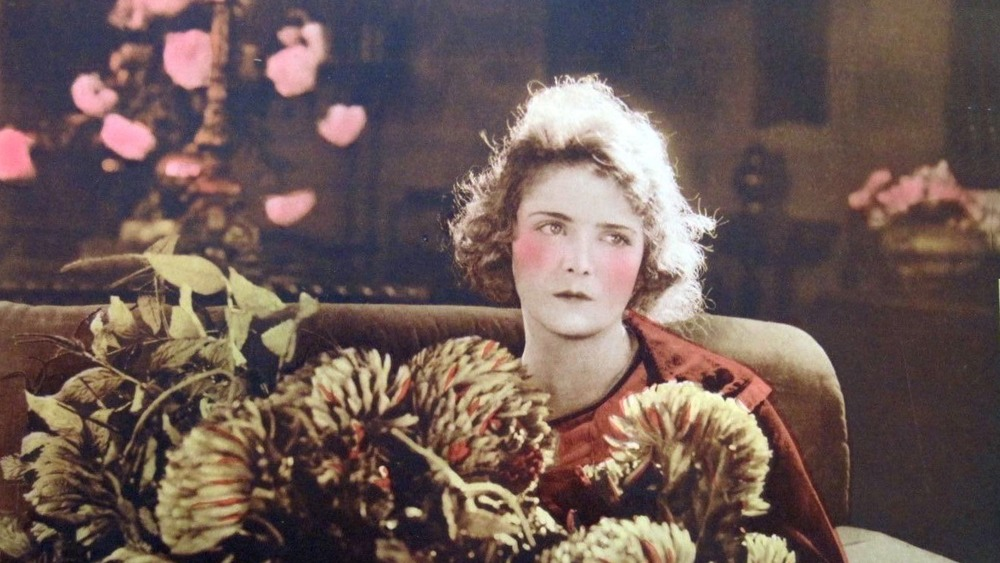 Lobby card showing actress Olive Thomas