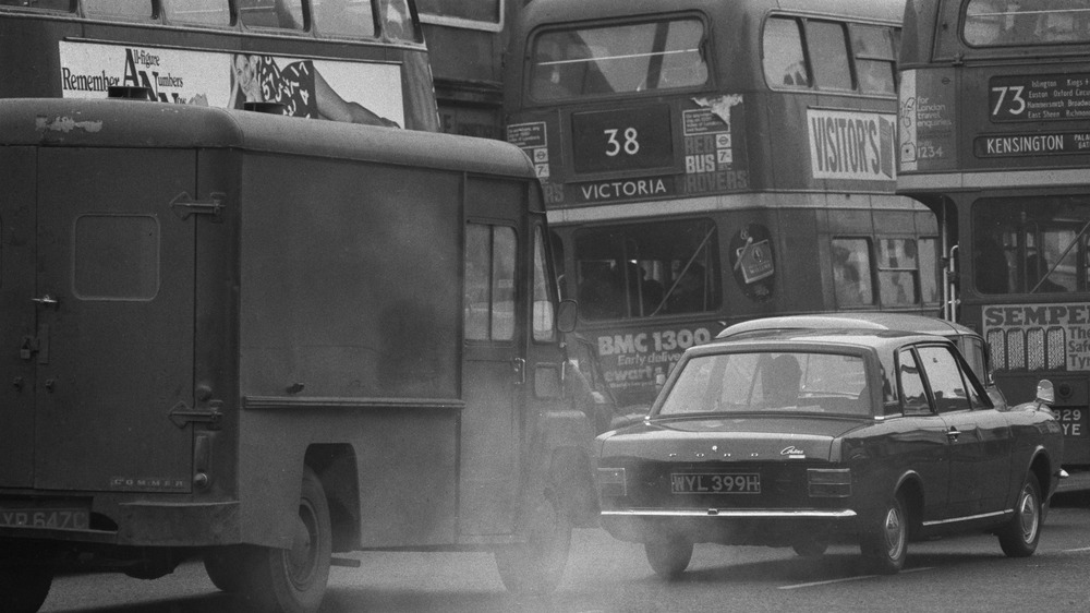 Busses on the road during smog.