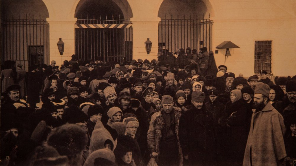Reproduction of prisoners, including families, being processed in a Siberia camp in the late Tsarist period.