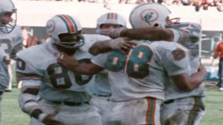 Members of the 1972 Dolphins celebrating