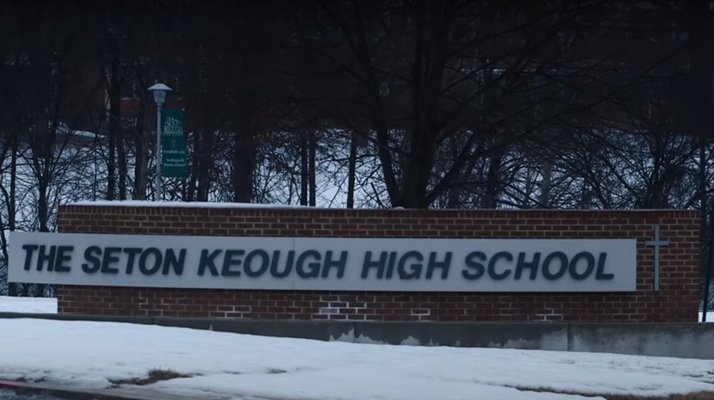 seton keough high school sign with snow