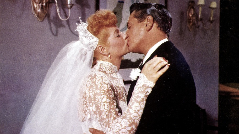 Lucille Ball and Desi Arnaz kissing after wedding vows
