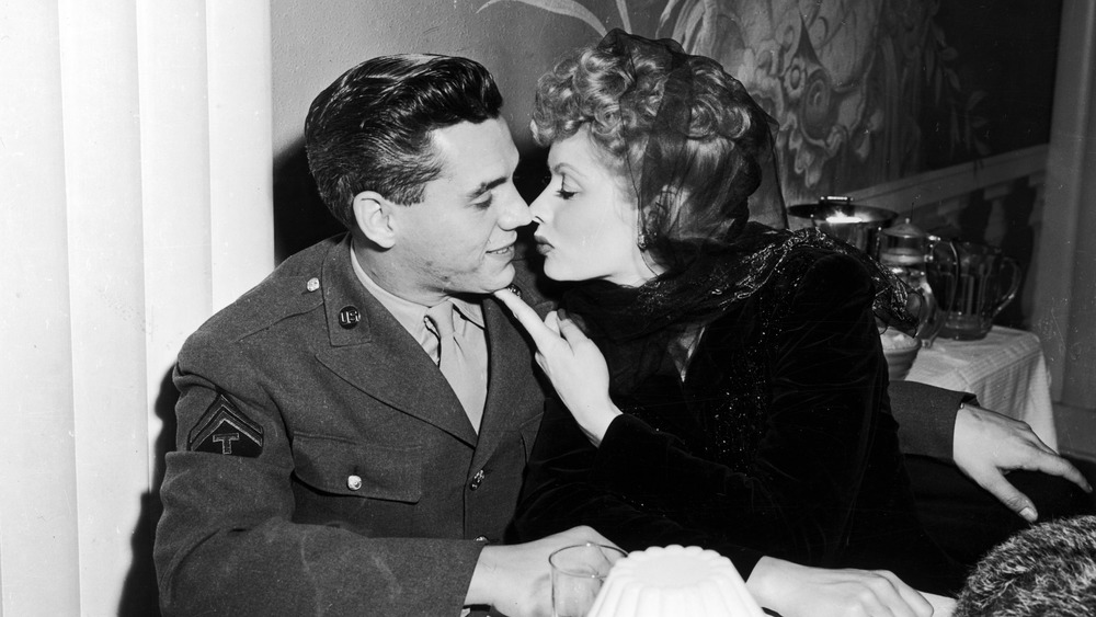 Lucille Ball and Desi Arnaz nearly kissing