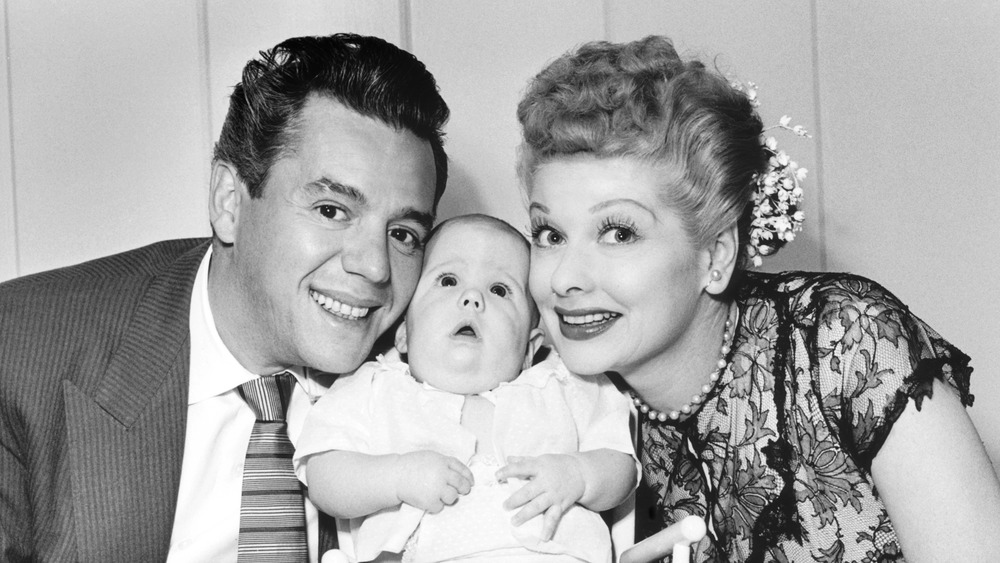 Desi Arnaz and Lucille Ball pose with their son