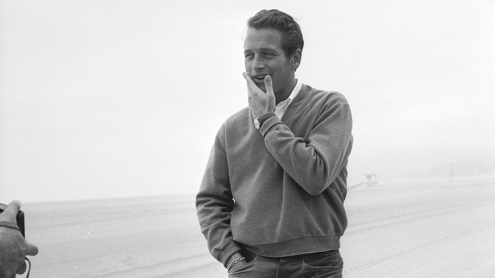 Paul Newman with hand on face