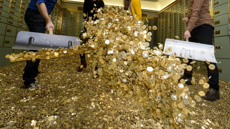 piles of money gold coins